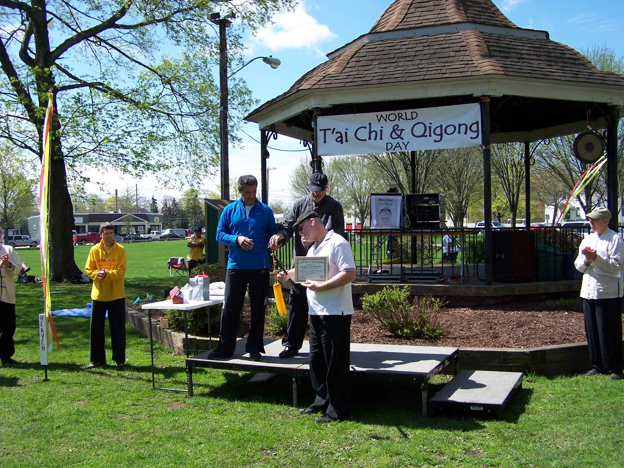 Thanking an old host with departing gifts, Laddie Sacharko was recognized for 12 years of leadership in organizing CT World Tai Chi Day